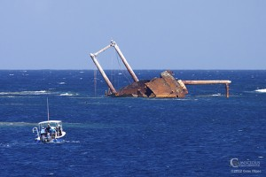A whale boat approaches the wreck of the Polyxeni on the Silver Bank