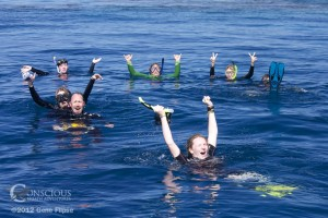 After swimminhg with whales, guests of Conscious Breath Adventures celebrate the experience